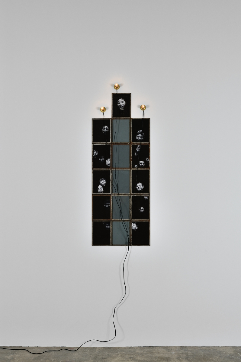 Christian Boltanski, Scratch, 2014. 16 frames, photographs, paint, light bulbs, electric wire. Image courtesy of the artist and Marian Goodman Gallery.